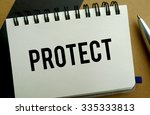 Protect memo written on a notebook with pen - stock photo