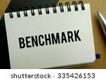 Benchmark memo written on a notebook with pen - stock photo