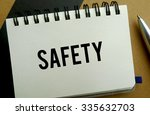 Safety memo written on a notebook with pen - stock photo