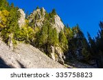 rocky hillside of mountain range with coniferous forest in Apuseni National Park in Romania - stock photo
