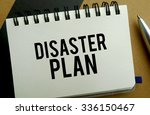 Disaster plan memo written on a notebook with pen - stock photo