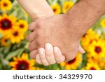 Hands on  sunflower background - stock photo
