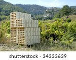 Wooden crates in the vineyard, ready for the harvest in France - stock photo