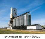Grain Elevator and Bins with Blue Sky - stock photo