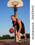 Basketball player dribbling ball - stock photo