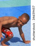 Boy playing at water park - stock photo