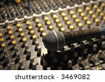 microphone on soundboard under theater lighting - stock photo