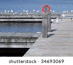 Harbor with a dock and boat slips - stock photo