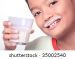 boy with milk mustache - stock photo