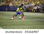 EAST RUTHERFORD NJ - AUGUST 12: Miguel Ibarra #4 of Ecuador handles the ball against Jamaica during the International Friendly match at Giants Stadium on August 12 2009 in East Rutherford NJ - stock photo