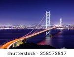 Akashi Kaikyo Bridge spanning the Seto Inland Sea from Awaji Island to Kobe, Japan. - stock photo