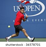 NEW York - September 5: Roger Federer of Switzerland returns a shot during 3rd round match against Lleyton Hewitt of Australia at US Open on September 5 2009 in New York - stock photo