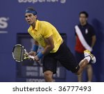 NEW YORK - SEPTEMBER 8: Rafael Nadal of Spain returns a shot during 4th round match against Gael Monfils of France at US Open on September 8, 2009 in New York - stock photo