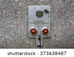 Standpipe connectors. Metal fire department standpipe connections with red covers on granite wall - stock photo