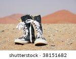 Jeans shoe in desert - stock photo