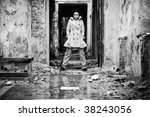 Young woman in a ruined building. Black and white concept. - stock photo