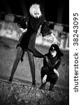 Two goth women. Contrast black and white colors. - stock photo