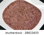 Flax seeds on plate - stock photo