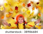 Girl child in autumn orange hat with outstretched arm.  Outdoor. - stock photo