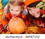 Happy family with child on autumn orange leaf, pumpkin.Outdoor. - stock photo