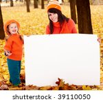 Happy family, child on autumn orange leaf with banner. Outdoor. - stock photo