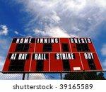 Baseball scoreboard with bat ball and strike zones and blue sky - stock photo