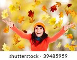 Girl in autumn orange hat with outstretched arm. Outdoor. - stock photo