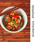 Bowl of Stewed Chicken and Vegetables over White Rice on Bamboo Placemat - stock photo