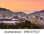 Himeji, Japan cityscape and castle corner tower. - stock photo
