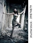 Young woman in a ruined building. Lens distortion effect for more dramatic. - stock photo