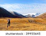 jumping girl mountain landscape - stock photo