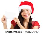 Christmas woman holding blank paper sign. Very beautiful mixed race asian / caucasian woman smiling. Isolated on white background. - stock photo