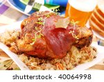 pork knuckle baked with beer and sauerkraut - stock photo