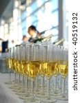 A rows of the wineglasses with champagne in the restaurant - stock photo