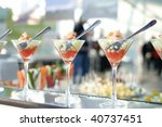Three shrimp cocktails in a martini glass with fork inside. - stock photo