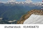 Last snow on the top of the mountain, view from the heights of the Caucasus Mountains - stock photo