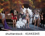 NEW YORK - NOVEMBER 19: Victoria's Secret Fashion Show finale all models walk runway on November 19, 2009 at the Lexington Armory in New York City. - stock photo