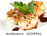 scallop seared with sesame seeds and ginger with hoisin sauce, garnished with parsley - stock photo