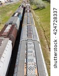 Two lines of grain cars on railway tracks - stock photo