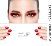 Beauty Makeup and Nail Art Concept. Beautiful fashion model woman with red smoky eye makeup to match her manicured nails, foundation on a unblemished skin, half face with a white card template.  - stock photo
