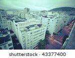 dusk view over tops of residential buildings favelas and mountains in Copacabana Rio de Janeiro Brazil - stock photo