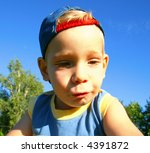 Goofy portrait of a boy with the hat - stock photo