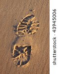 Boot print in the sand - stock photo