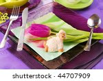 table decorated for easter time in purple and green colors - stock photo