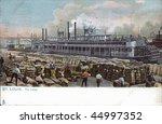 Dock scene paddle wheel steam ship historic postcard 1907 - stock photo