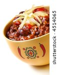 Bowl of chili with peppers and beans, topped with grated cheese. - stock photo