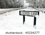 school lane street sign covered in snow - stock photo