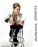 Young woman holding a hair dryer and scissors. - stock photo