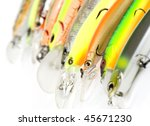 Plastic fishing lures forming a row,  shot with 100/2.8 Macro prime lens - stock photo