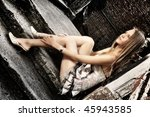 The young beautiful girl in a grey dress - stock photo